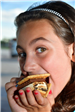 girl eating a smore