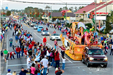 parade floats driving down Highway 59