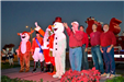 councilmen, frosty the snowman and rudolph on stage