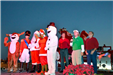 frosty the snowman, rudolph and councilmen on stage