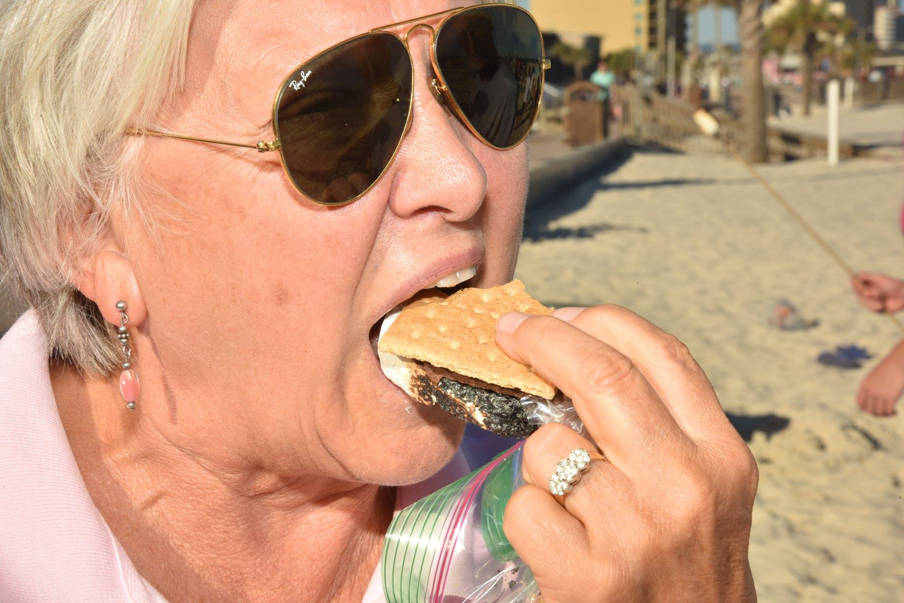 woman eating a smore