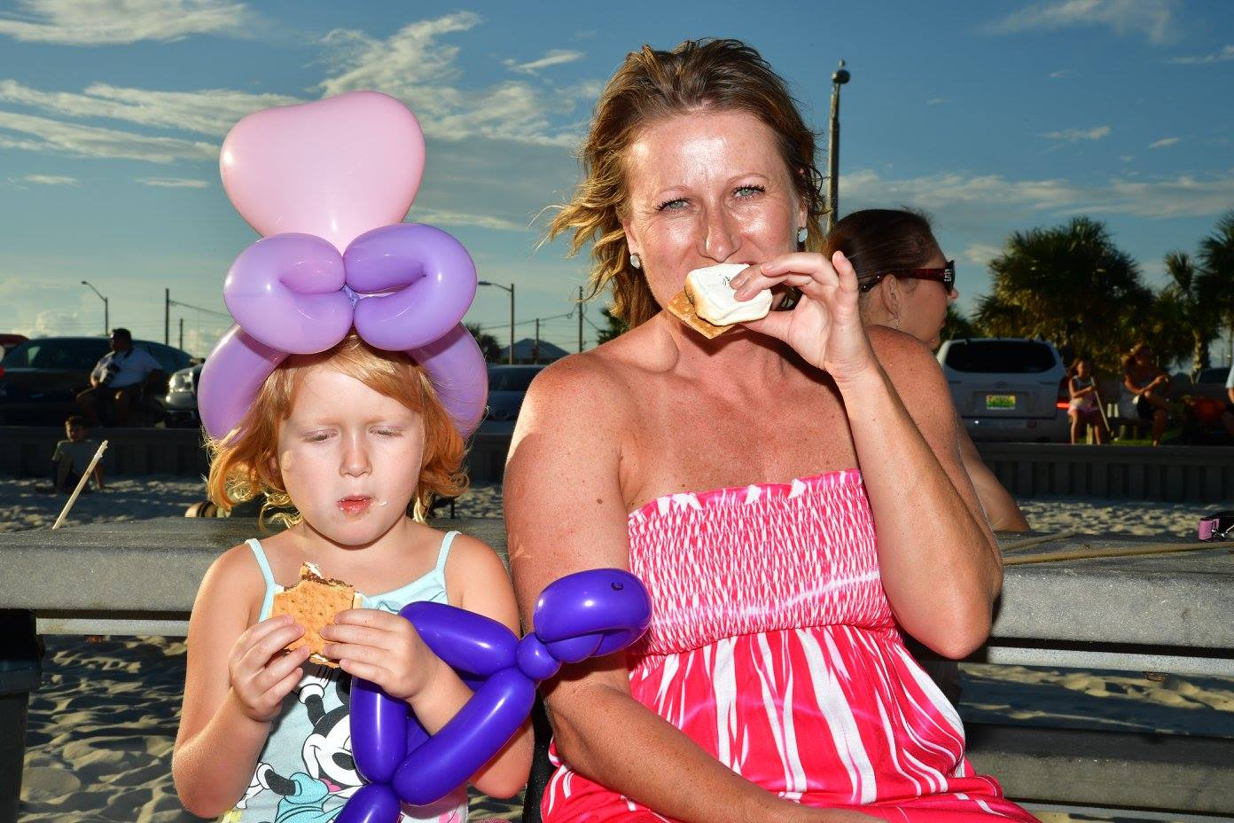 woman and daughter eating a smore