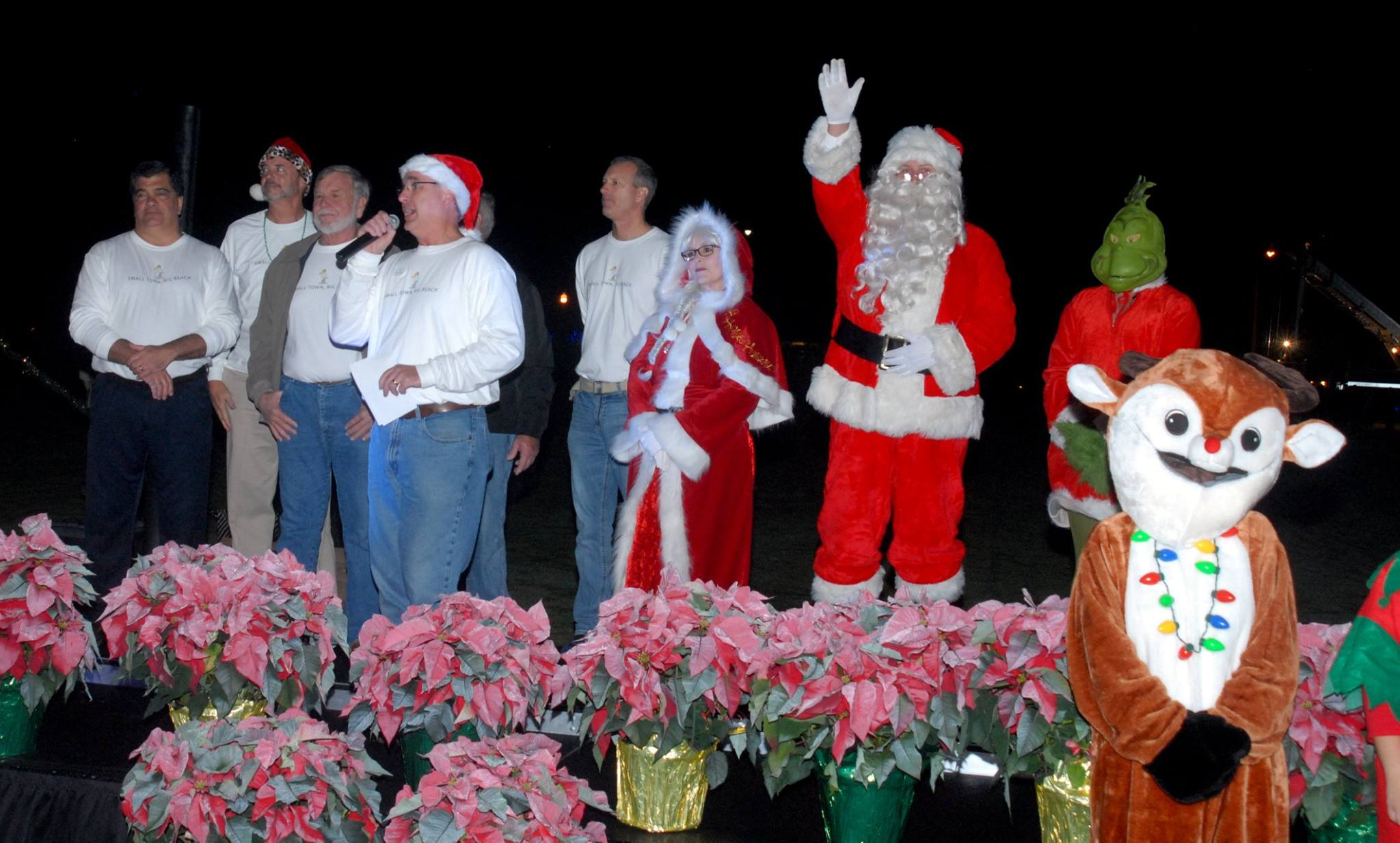 councilmen and santa on stage